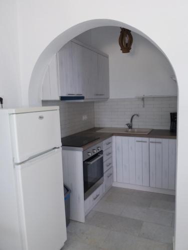 A kitchen or kitchenette at Studios Kontos