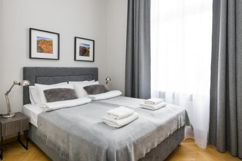 Lova arba lovos apgyvendinimo įstaigoje Yourplace Biskupia Aparthotel