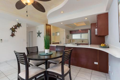 A kitchen or kitchenette at Castle Waikiki Shore Beachfront Condominiums