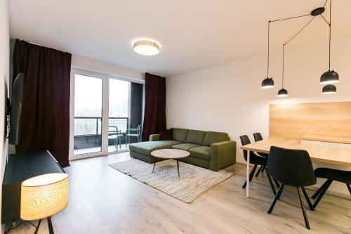 A seating area at Urban Residence Apartments