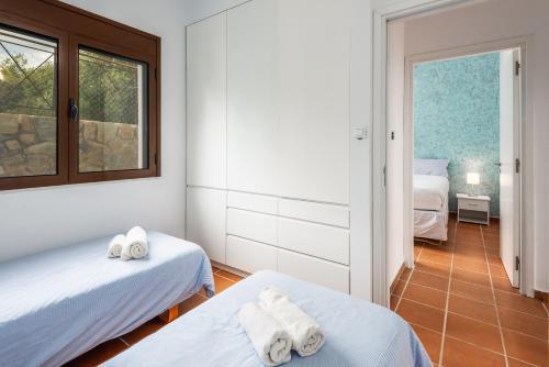 Łóżko lub łóżka w pokoju w obiekcie SOUTHERN DREAMS APARTMENTS