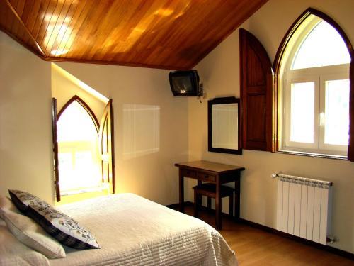 Un ou plusieurs lits dans un hébergement de l'établissement Chalé de Soutelinho