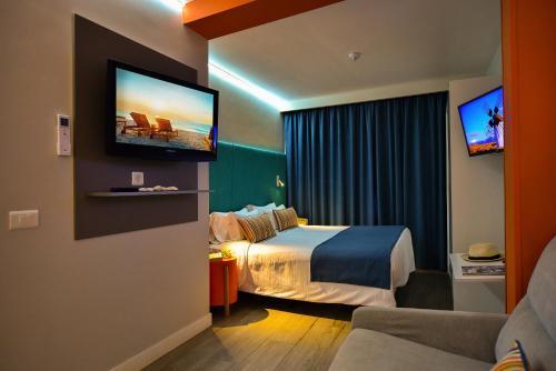 Cama o camas de una habitación en Hotel Apartamento Bajamar