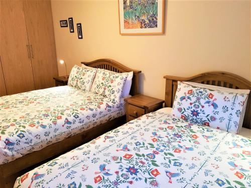 A bed or beds in a room at Halfpenny Bridge Holiday Homes - Connemara Girl