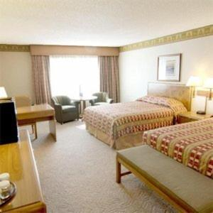 A bed or beds in a room at High Desert Inn