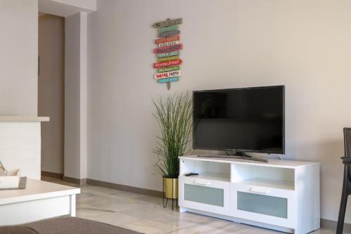A television and/or entertainment center at Rio Marinas Apartments Casasol