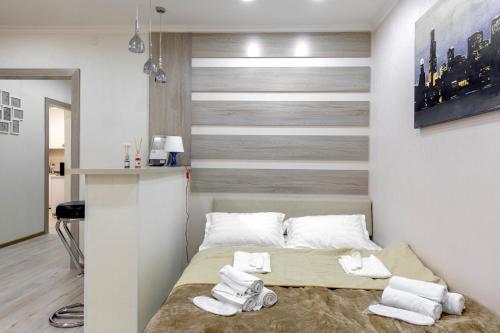 Кровать или кровати в номере Prego Apartments in Vremena Goda