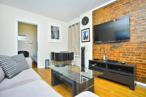 A television and/or entertainment center at Yorkville Apartments -Upper East Side