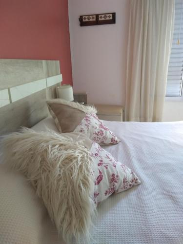 Una cama o camas en una habitación de BellaVista Departamento Temporario
