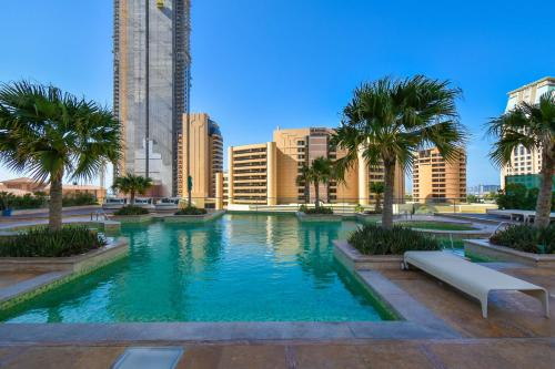 The swimming pool at or near Cosy 2 beds JBR Dubai