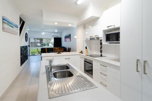 A kitchen or kitchenette at TiTree Resort Apartments