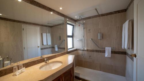 Ein Badezimmer in der Unterkunft Vila Petra