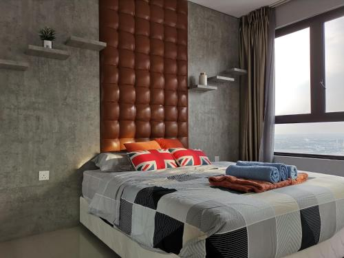 A bed or beds in a room at Eminent Suite @ I-City, Shah Alam
