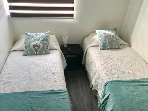 Cama o camas de una habitación en In Out Apartments Las Condes