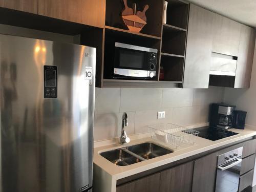 Una cocina o zona de cocina en In Out Apartments Las Condes