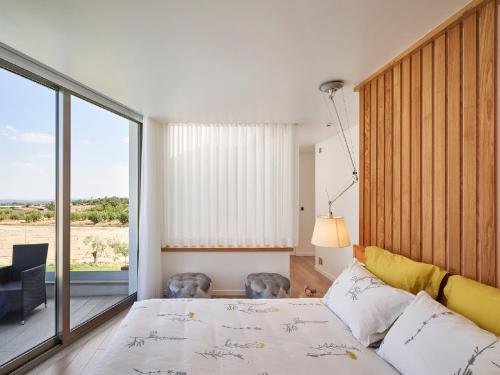 A bed or beds in a room at Villa Vila Oliveira