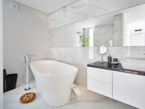 A bathroom at Villa Vila Oliveira