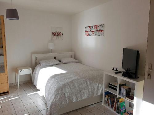Un ou plusieurs lits dans un hébergement de l'établissement Appart Hôtel L'Angélique