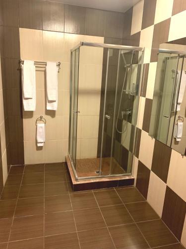 Ванная комната в Версаль Отель