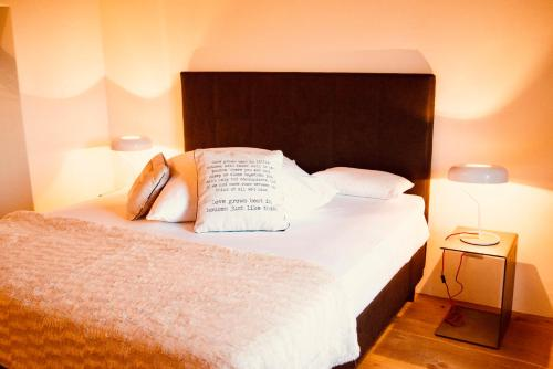 A bed or beds in a room at Casa Fortuna