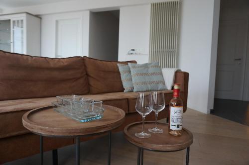 Coin salon dans l'établissement Appartement Mariakerke-Bad Zeezicht