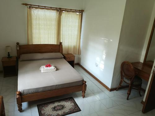 A bed or beds in a room at Residence Charlette