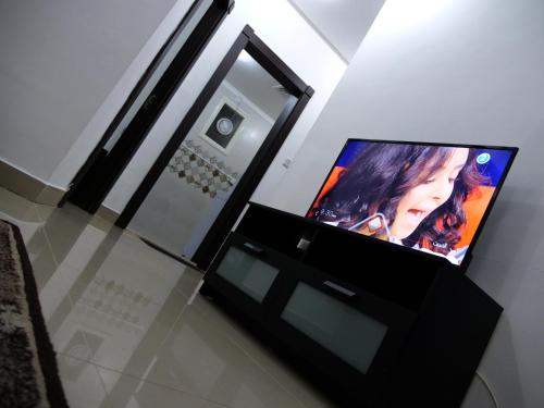 A television and/or entertainment center at Heidelberg Apartment