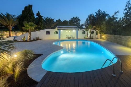 The swimming pool at or near Villa Can Martona