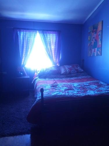 A bed or beds in a room at Habitación Independiente