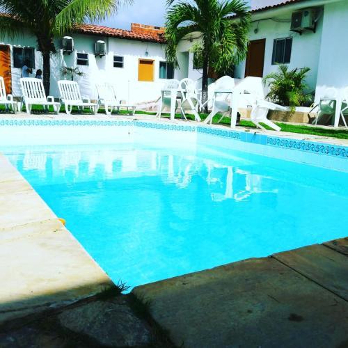 The swimming pool at or close to Pousada Maceio