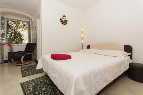 Postelja oz. postelje v sobi nastanitve LCT Venetian Apartment