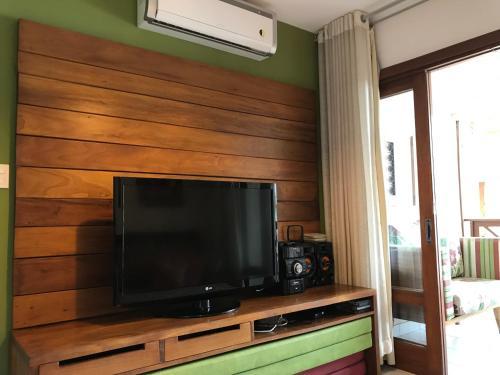 TV a/nebo společenská místnost v ubytování Enseada Praia do Forte