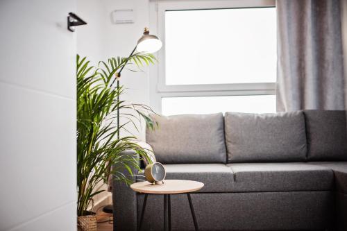 A seating area at E-Apartamenty Bułgarska