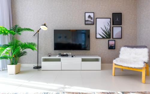 A television and/or entertainment center at FAM Living - Mada Residences Downtown Dubai