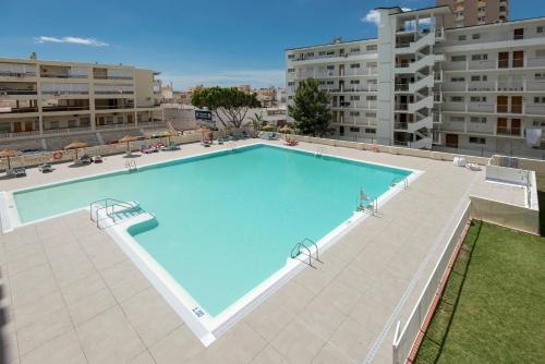 A view of the pool at Apartamentos Nucleo Cristal or nearby