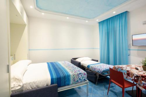 A bed or beds in a room at IL SOFFIO DI TIFEO - RESORT