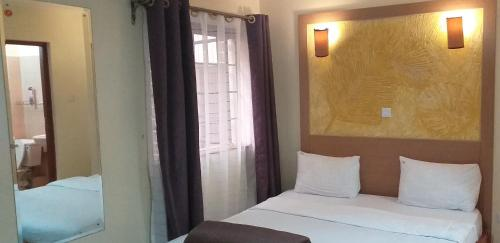 A bed or beds in a room at Mvuli Studio Suites Nairobi