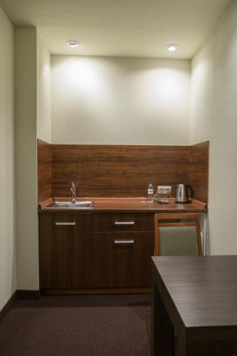 A kitchen or kitchenette at Zolotoy Zaton Business hotel