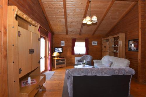 Ein Sitzbereich in der Unterkunft Ferienanlage Reinsberger Dorf