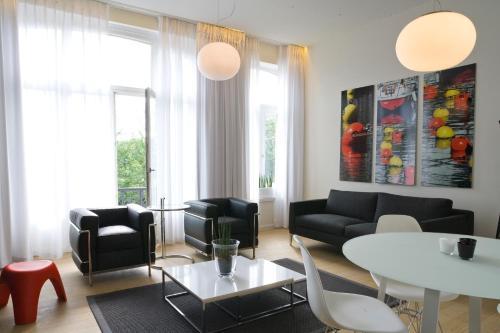 Coin salon dans l'établissement Leopold5 Luxe-Design Apartment