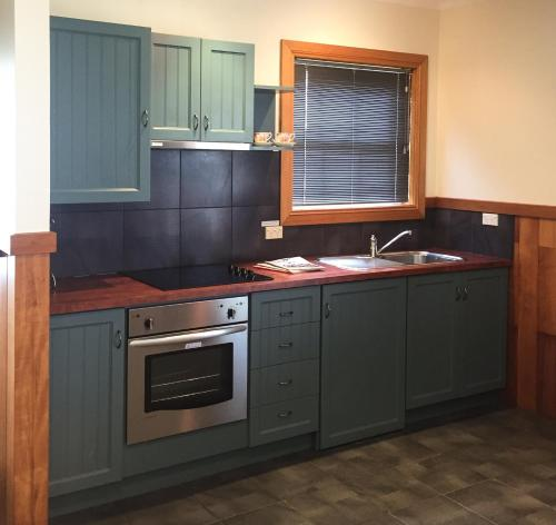 A kitchen or kitchenette at Stanley Hotel & Apartments