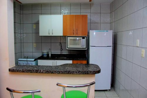 A kitchen or kitchenette at Apto 129 para 6 pessoas Thermas Paradise