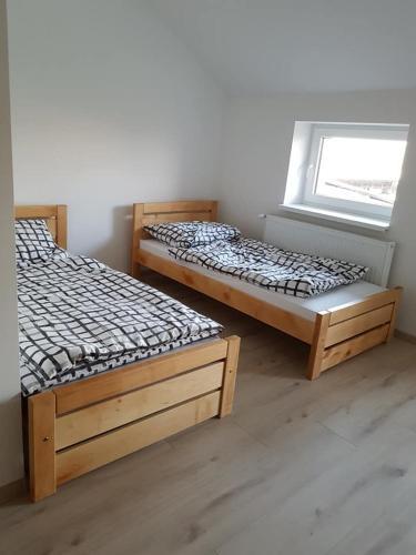 Posteľ alebo postele v izbe v ubytovaní Penzión JK Betty
