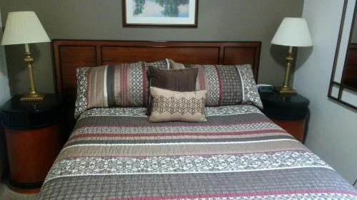 A bed or beds in a room at Nauvoo Vacation Condos and Villas
