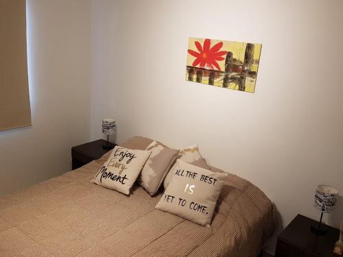 Una cama o camas en una habitación de Departamento MOLDES 2