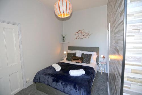 Voodi või voodid majutusasutuse Nunthorpe Road Apartment toas