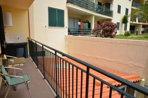 Uma varanda ou terraço em Palheiro Residence