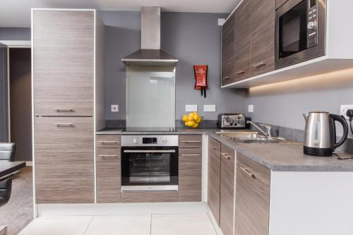 A kitchen or kitchenette at Dream Apartments St Thomas Hall