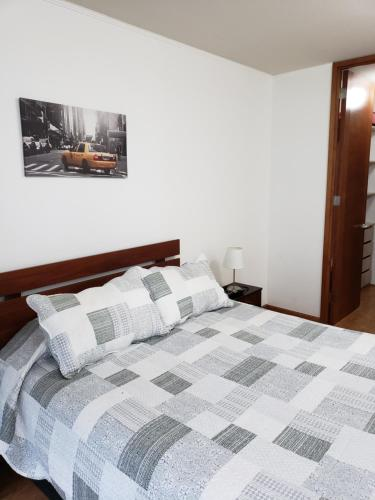 Cama o camas de una habitación en Arriendos LC
