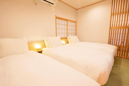 A bed or beds in a room at T-home